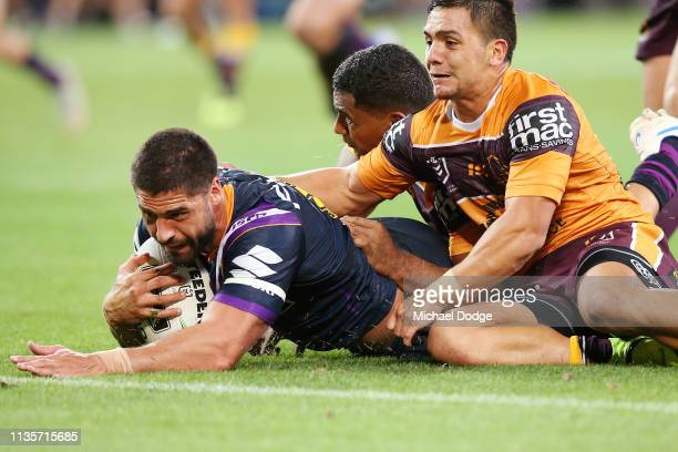 Jesse Bromwich of the Storm scores a try during the round one NRL match between the Melbourne Storm and the Brisbane Broncos at AAMI Park on March 14...