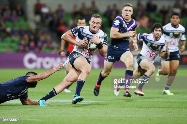 Jesse Bromwich of the Storm tackles Coen Hess of the Cowboys during the round three NRL match between the Melbourne Storm and the North Queensland...
