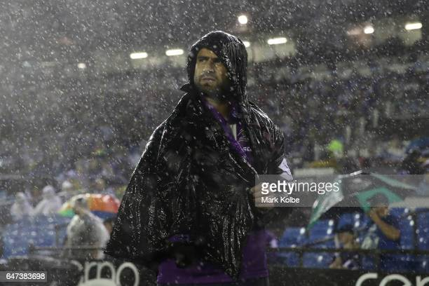 Jesse Bromwich of the Storm watches on from the sideline with an injury during the round one NRL match between the Canterbury Bulldogs and the...