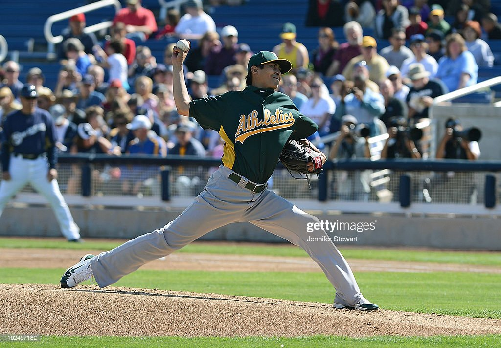 Jesse Chavez #60 of the Oakland Athletics pitches in the spring training game against the Milwaukee Brewers in the first inning at Maryvale Baseball Park on February 23, 2013 in Phoenix, Arizona.
