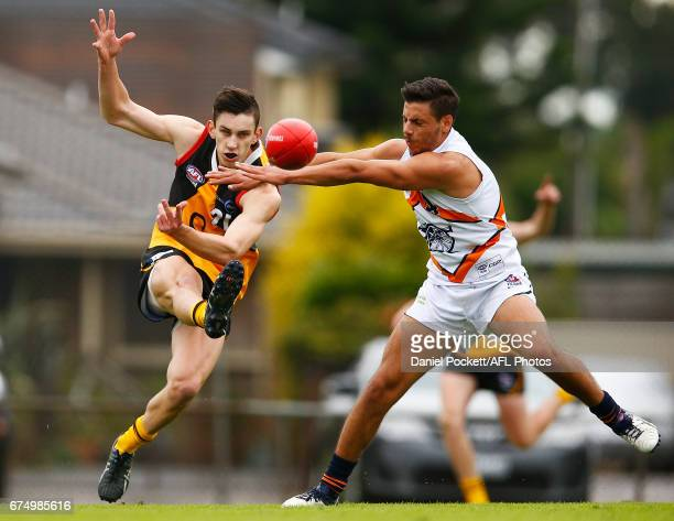 Jesse Davies of the Stingrays kicks under pressure during the round five TAC Cup match between Dandenong and Calder at Shepley Oval on April 30 2017...