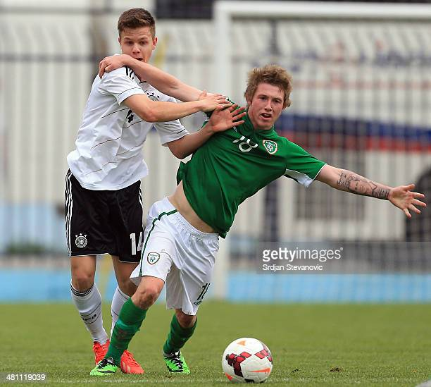 Jesse Devers of Ireland is challenged by Patrick Kammerbauer of Germany during the UEFA Under17 Elite Round between Germany and Ireland at Stadion FC...