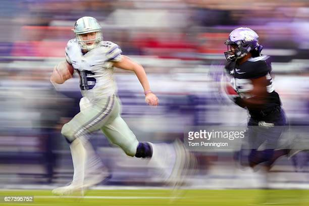 Jesse Ertz of the Kansas State Wildcats scores a touchdown against Travin Howard of the TCU Horned Frogs in the second quarter at Amon G Carter...