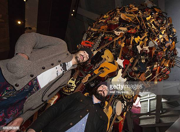 Jesse F. Keeler and Sebastien Grainger of the Death from Above 1979 pose near the guitar sculpture 'If VI was IX' before performing an EndSession...