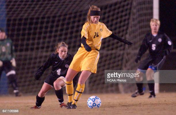 Jesse Fream of Kennesaw State controls the ball as Franklin Pierce's Kristen Lake plays defense during the Division 2 Women's Soccer Championship...