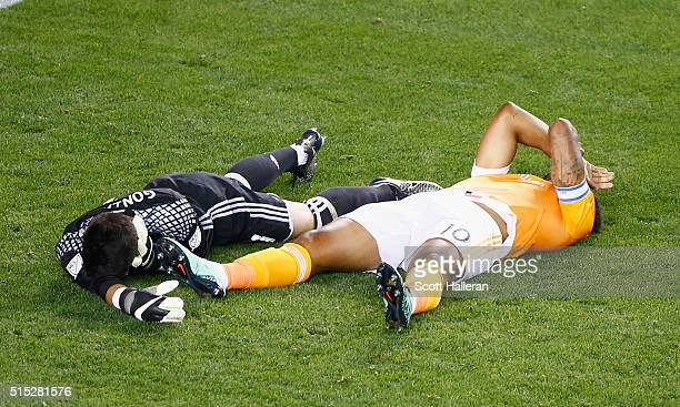 Jesse Gonzalez of FC Dallas and Giles Barnes of the Houston Dynamo wait on the pitch after colliding during their game at BBVA Compass Stadium on...