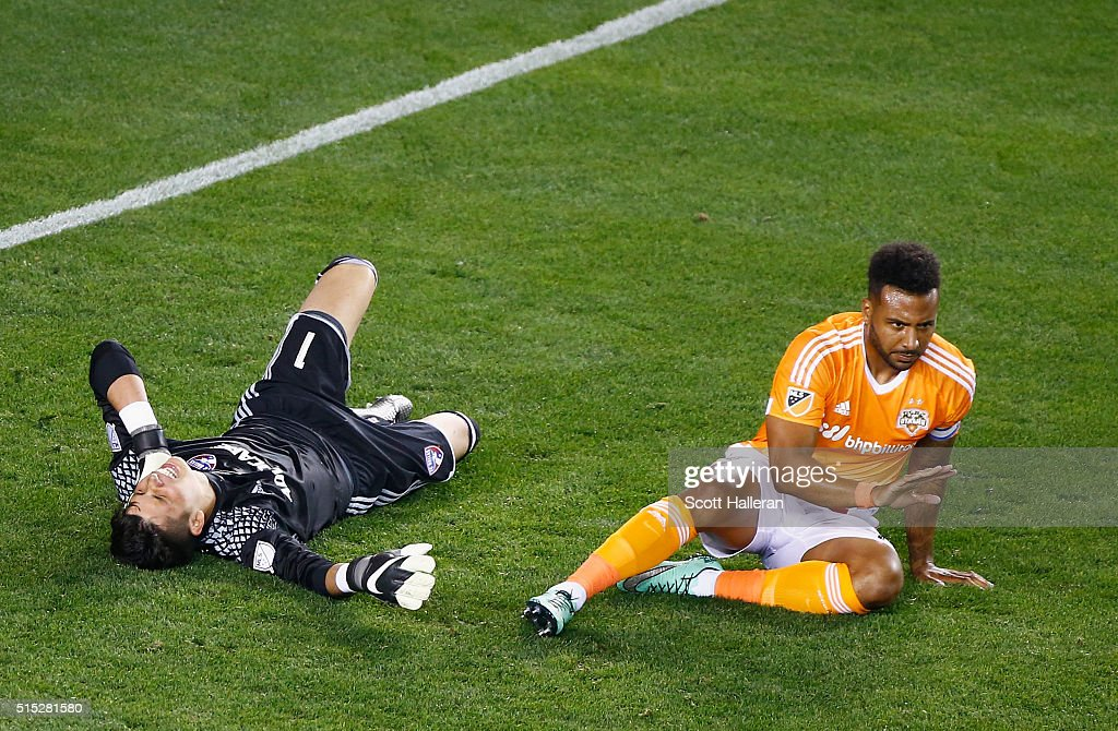 Jesse Gonzalez #1 of FC Dallas and Giles Barnes #10 of the Houston Dynamo wait on the pitch after colliding during their game at BBVA Compass Stadium on March 12, 2016 in Houston, Texas.