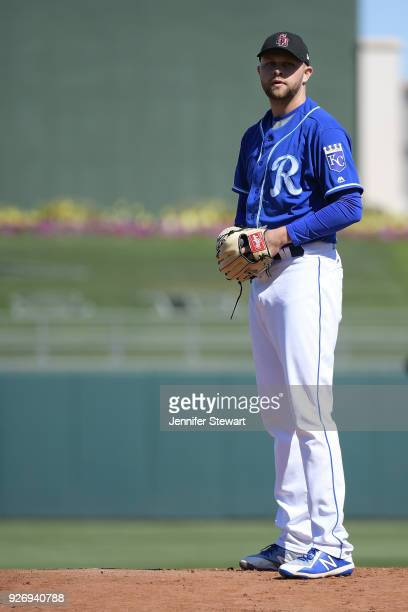 Jesse Hahn of the Kansas City Royals throws a warm up pitch prior to the first inning of the spring training game against the Los Angeles Dodgers at...