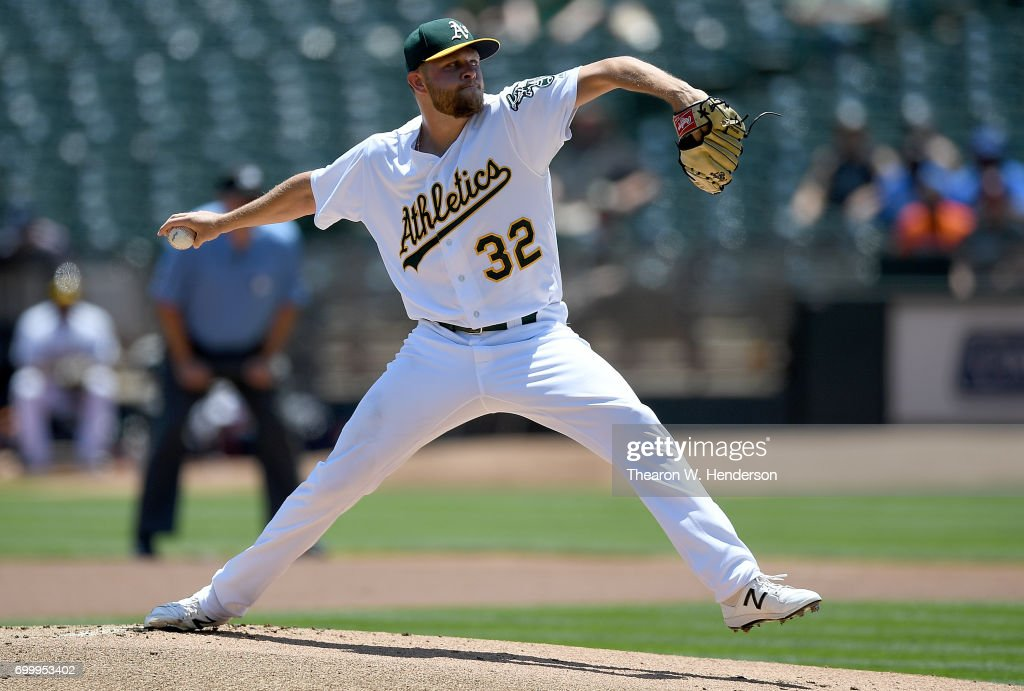 Jesse Hahn #32 of the Oakland Athletics pitches against the Houston Astros in the top of the first inning at Oakland Alameda Coliseum on June 22, 2017 in Oakland, California.