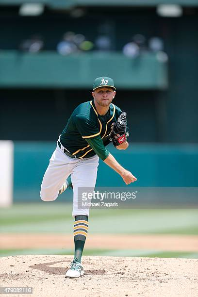 Jesse Hahn of the Oakland Athletics pitches during the game against the Los Angeles Angels of Anaheim at Oco Coliseum on June 20 2015 in Oakland...