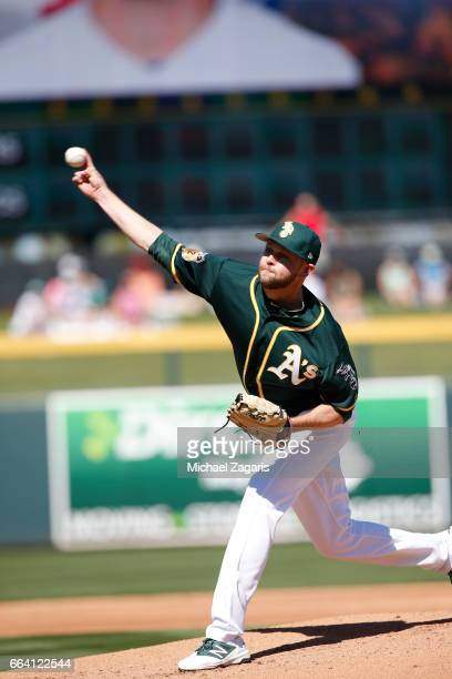 Jesse Hahn of the Oakland Athletics pitches during the game against the Texas Rangers at Hohokam Stadium on March 2 2017 in Mesa Arizona