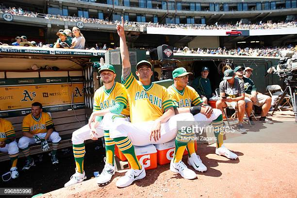Jesse Hahn Sean Manaea and Tyler Ladendorf of the Oakland Athletics relax in the dugout during the game against the Chicago Cubs at the Oakland...