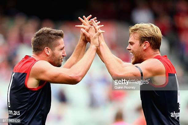 Jesse Hogan and Jack Watts of the Demons celebrates a goal during the round one AFL match between the Melbourne Demons and the Greater Western Sydney...