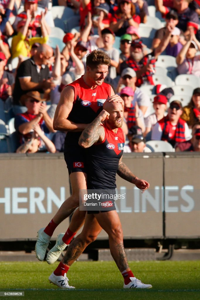 Jesse Hogan and Nathan Jones of the Demons celebrate a goal during the round three AFL match between the Melbourne Demons and the North Melbourne Kangaroos at Melbourne Cricket Ground on April 7, 2018 in Melbourne, Australia.