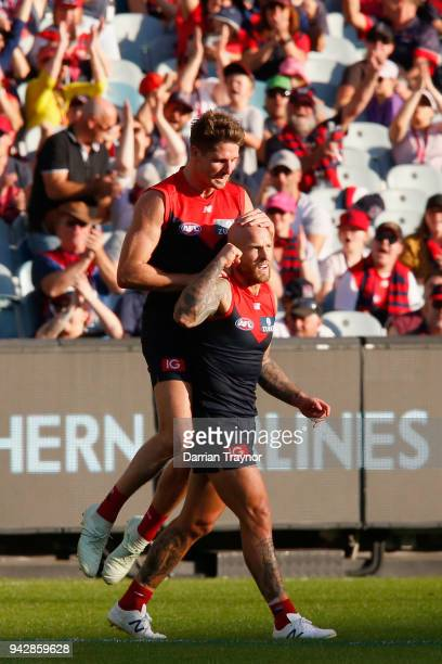 Jesse Hogan and Nathan Jones of the Demons celebrate a goal during the round three AFL match between the Melbourne Demons and the North Melbourne...