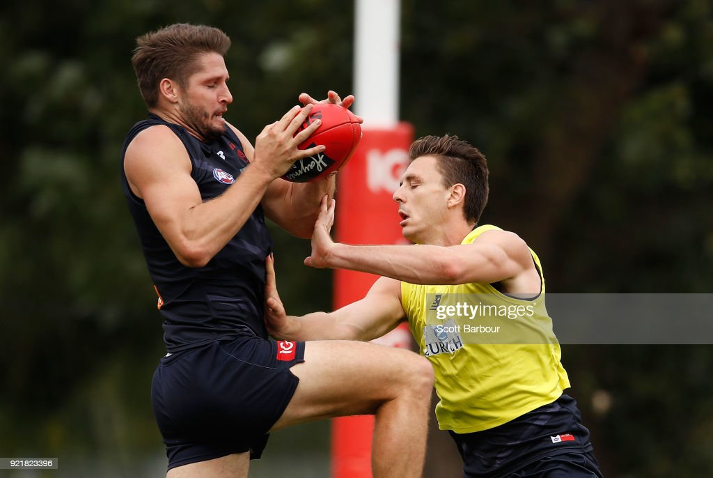 Jesse Hogan is tackled during a Melbourne Demons AFL training session at Gosch's Paddock on February 21, 2018 in Melbourne, Australia.