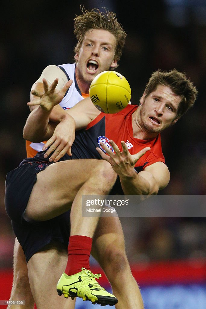 Jesse Hogan of the Demons (R) and Aidan Corr of the Giants compete for the ball during the round 23 AFL match between the Melbourne Demons and the Greater Western Sydney Giants at Etihad Stadium on September 6, 2015 in Melbourne, Australia.