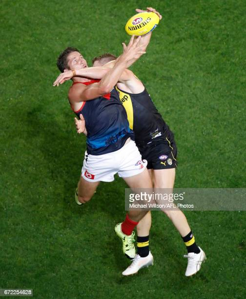 Jesse Hogan of the Demons and Josh Caddy of the Tigers compete for the ball during the 2017 AFL round 05 match between the Richmond Tigers and the...