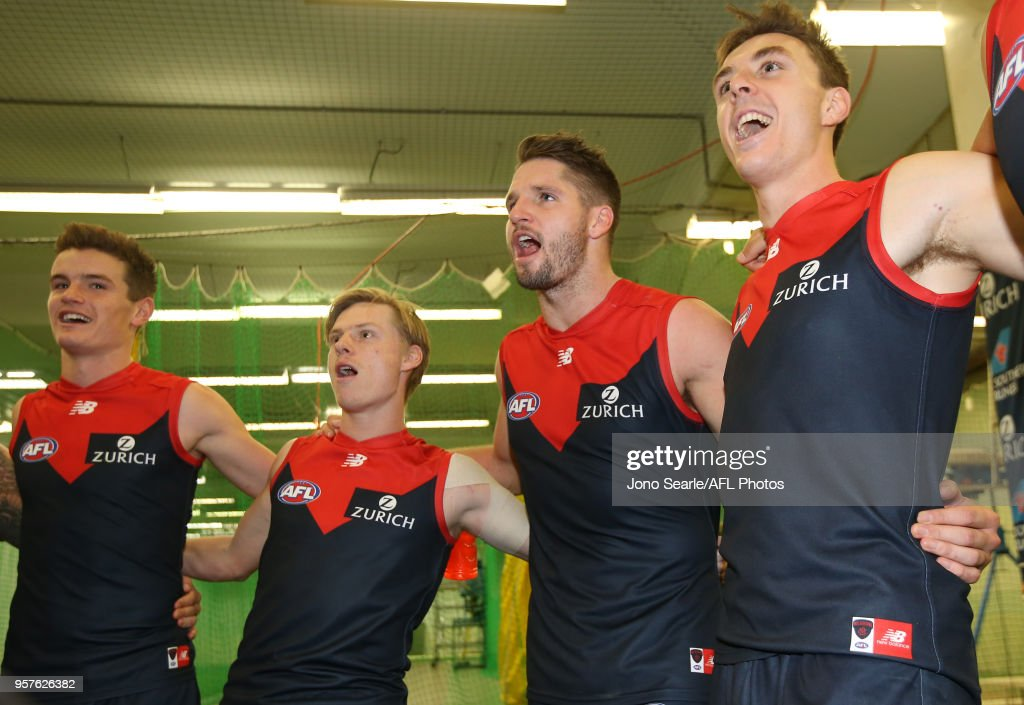 Jesse Hogan of the Demons (second right) celebrates the win with team mates after the round eight AFL match between the Gold Coast Suns and the Melbourne Demons at The Gabba on May 12, 2018 in Brisbane, Australia.