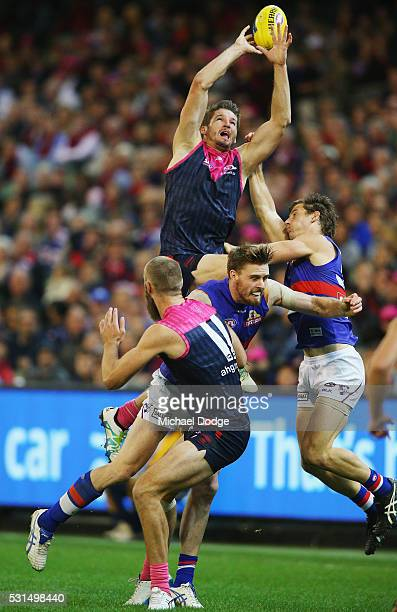 Jesse Hogan of the Demons competes for the ball over Jordan Roughead of the Bulldogs during the round eight AFL match between the Melbourne Demons...