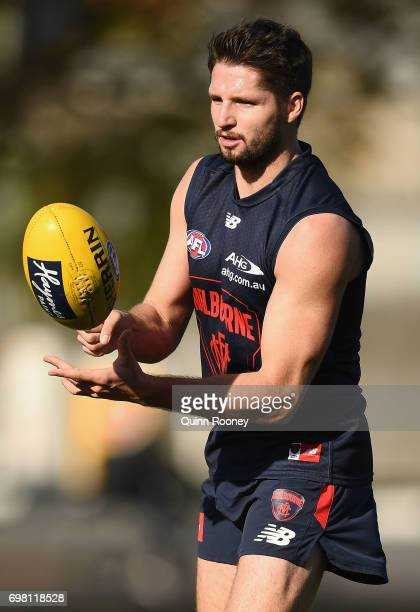 Jesse Hogan of the Demons handballs during a Melbourne Demons AFL training session at Gosch's Paddock on June 20 2017 in Melbourne Australia