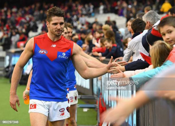 Jesse Hogan of the Demons high fives fans after winning the round nine AFL match between the Carlton Blues and the Melbourne Demons at Melbourne...
