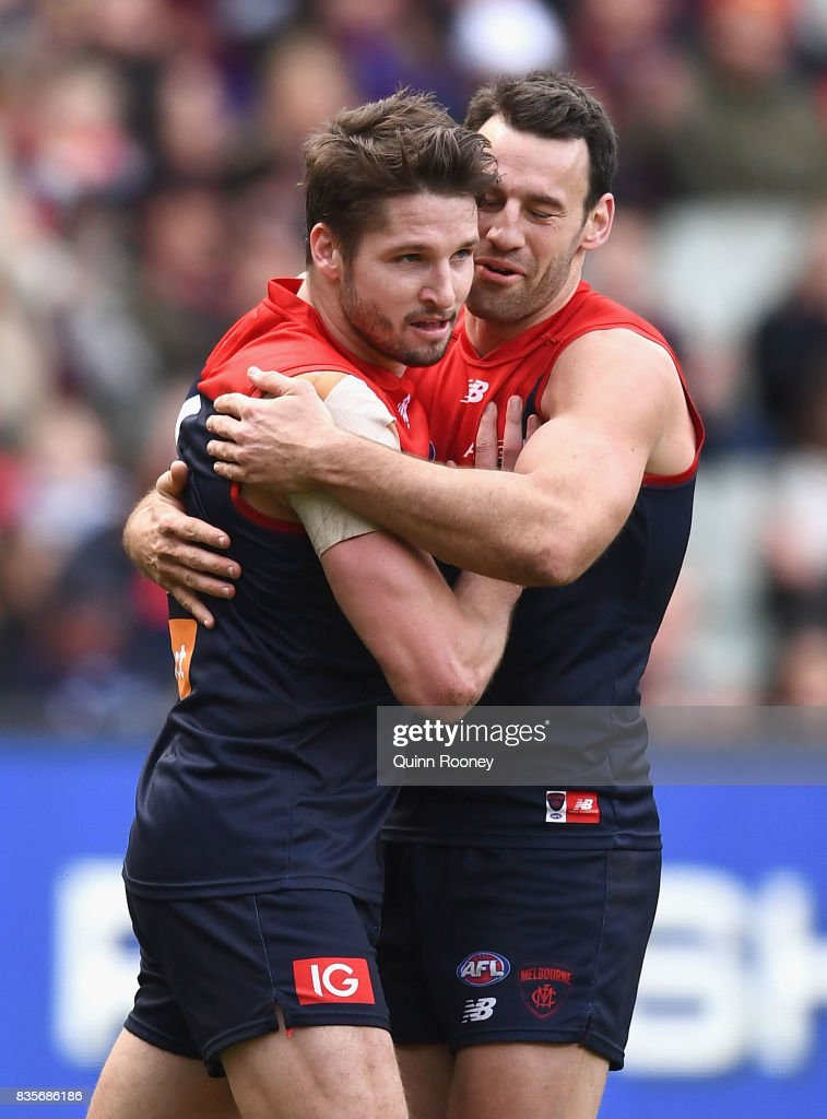 Jesse Hogan of the Demons is congratulated by Cameron Pedersen after kicking a goal during the round 22 AFL match between the Melbourne Demons and the Brisbane Lions at Melbourne Cricket Ground on August 20, 2017 in Melbourne, Australia.