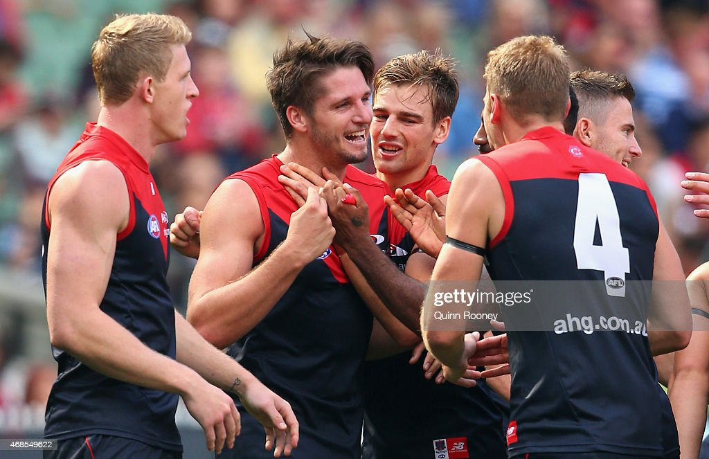 Jesse Hogan of the Demons is congratulated by team mates after kicking a goal during the round one AFL match between the Melbourne Demons and the Gold Coast Suns at Melbourne Cricket Ground on April 4, 2015 in Melbourne, Australia.