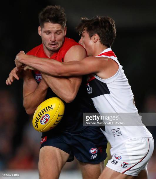 Jesse Hogan of the Demons is tackled by Jack Steele of the Saints during the AFL 2018 JLT Community Series match between the Melbourne Demons and the...