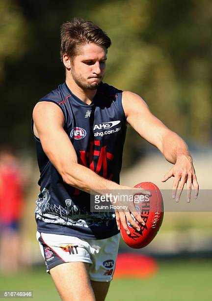 Jesse Hogan of the Demons kicks during a Melbourne Demons AFL training session at Gosch's Paddock on March 21 2016 in Melbourne Australia