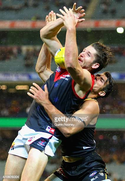 Jesse Hogan of the Demons marks infront of Alex Rance of the Tigers during the round four AFL match between the Richmond Tigers and the Melbourne...