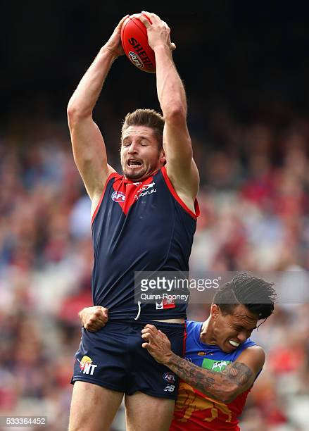 Jesse Hogan of the Demons marks infront of Allen Christensen of the Lions during the round nine AFL match between the Melbourne Demons and the...