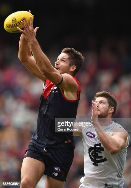Jesse Hogan of the Demons marks infront of Sam Rowe of the Blues during the round two AFL match between the Melbourne Demons and the Carlton Blues at...
