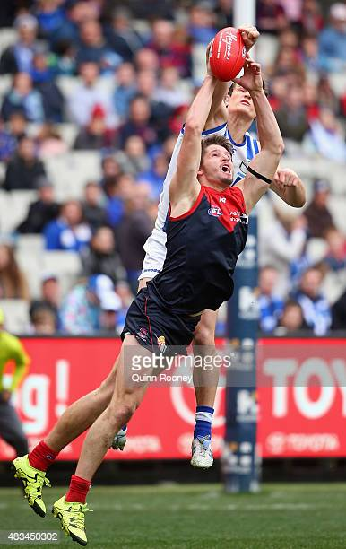 Jesse Hogan of the Demons marks infront of Scott Thompson of the Kangaroos during the round 19 AFL match between the Melbourne Demons and the North...