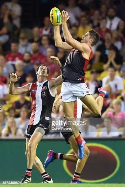 Jesse Hogan of the Demons marks over the top of Jake Carlisle of the Saints during the round one AFL match between the St Kilda Saints and the...