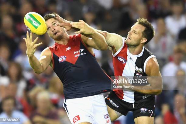 Jesse Hogan of the Demons marks over the top of Nathan Brown of the Saints during the round one AFL match between the St Kilda Saints and the...