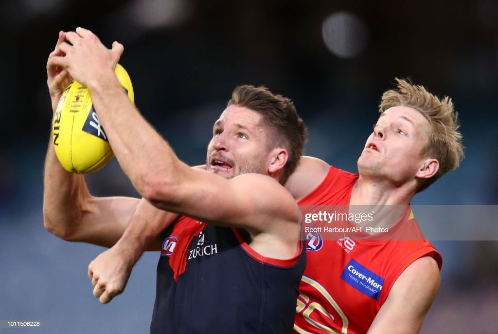 Jesse Hogan of the Demons marks the ball ahead of Max Spencer of the Suns during the round 20 AFL match between the Melbourne Demons and the Gold Coast Suns at Melbourne Cricket Ground on August 5, 2018 in Melbourne, Australia.