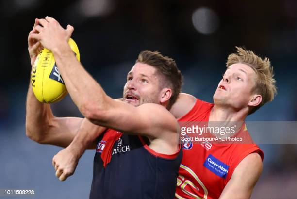 Jesse Hogan of the Demons marks the ball ahead of Max Spencer of the Suns during the round 20 AFL match between the Melbourne Demons and the Gold...