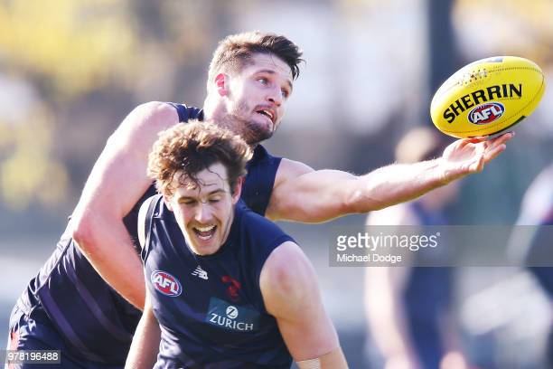 Jesse Hogan of the Demons marks the ball during a Melbourne Demons AFL training session at Gosch's Paddock on June 19 2018 in Melbourne Australia