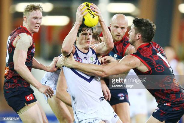 Jesse Hogan of the Demons tackled Andrew Brayshaw of the Dockers during the round 16 AFL match between the Melbourne Demons and the Fremantle Dockers...