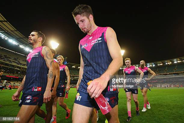 Jesse Hogan of the Demons walks off after defeat during the round eight AFL match between the Melbourne Demons and the Western Bulldogs at Melbourne...