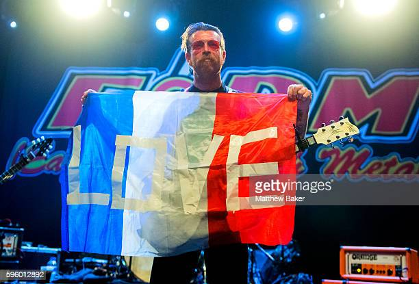 Jesse Hughes of Eagles of Death Metal holds a French tricolour as he performs at O2 Forum Kentish Town on August 26 2016 in London England