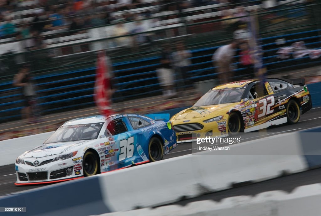 Jesse Iwuji #36 and Kody Vanderwal #32 jockey for position during the NASCAR K&N Pro Series West NAPA Auto Parts 150 on August 12, 2017 at Evergreen Speedway in Monroe, Washington. Chris Eggleston #99 finished first, followed by Will Rodgers #7 in second and Nicole Behar #33 in third.