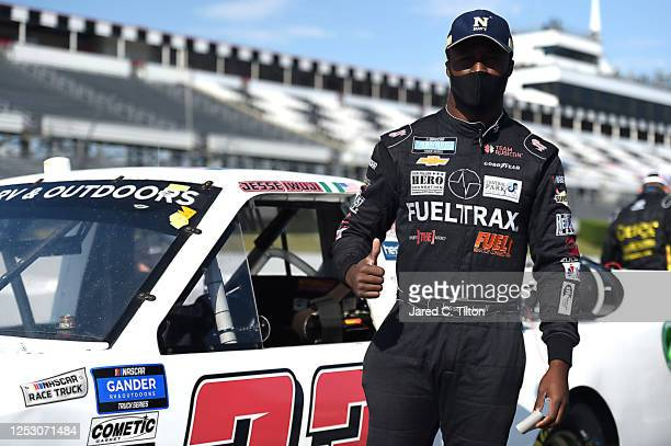 Jesse Iwuji, driver of the Reaume Brothers Racing Toyota, waits on the grid prior to the NASCAR Gander RV & Outdoors Truck Series Pocono Organics 150...