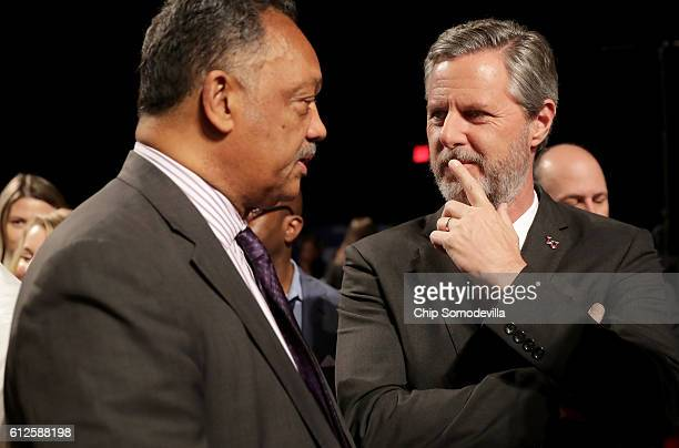 Jesse Jackson and Jerry Falwell Jr speak prior at the Vice Presidential Debate between Democratic vice presidential nominee Tim Kaine and Republican...