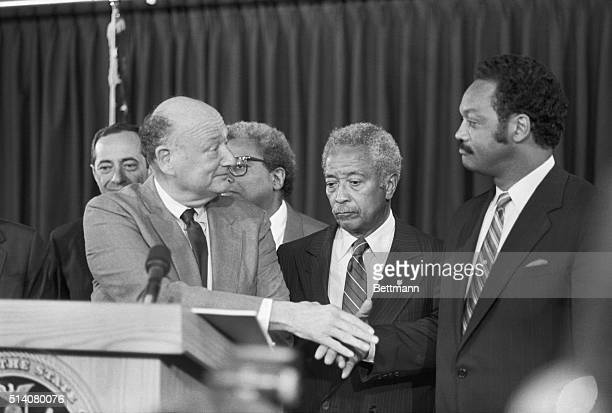 Jesse Jackson and New York Mayor Ed Koch shake hands meeting for the first time since the Presidential primary election in New York Manhattan Borough...