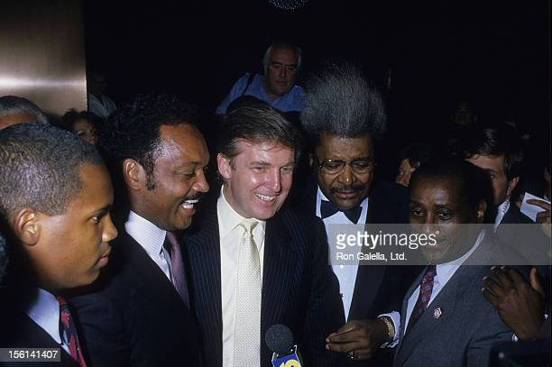 Jesse Jackson businessman Donald Trump Fight Promoter Don King and John H Johnson attend Mike Tyson vs Michael Spinks Boxing Match on June 27 1988 at...