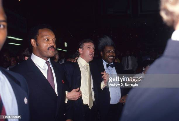 Jesse Jackson, Donald Trump and Don King speak at the Mike Tyson vs. Michael Spinks fight on June 27, 1988 in Atlantic City, New Jersey.