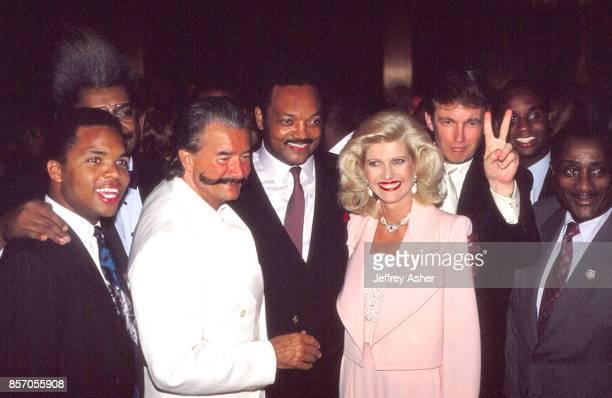 Jesse Jackson Jr with Don King Artist Leroy Nieman, Reverend Jesse Jackson Sr, Ivana Trump and Businessman Donald Trump flashing the victory sign,...