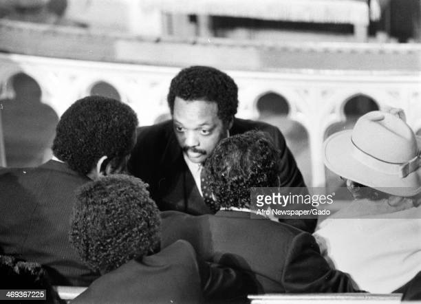 Jesse Jackson offers condolences to the Mitchell family as they attend a funeral March 1 1984
